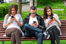 people-on-bench-phones